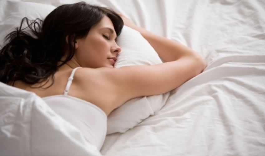 women sleeping in duvet